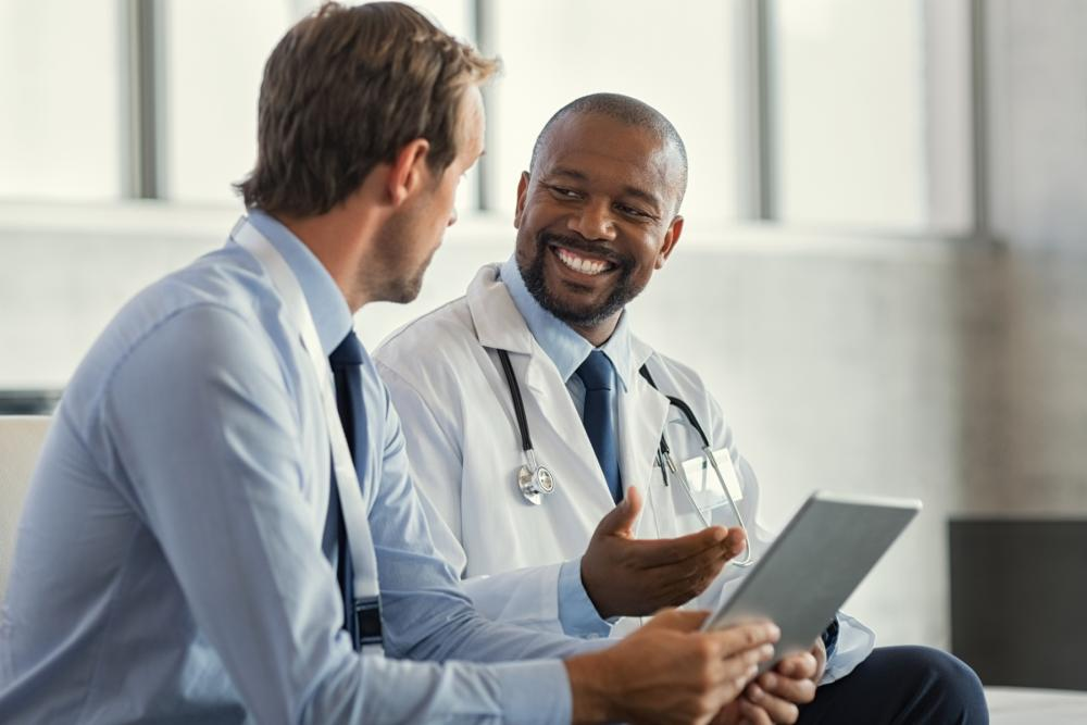 Image of a businessman and a doctor talking with each other