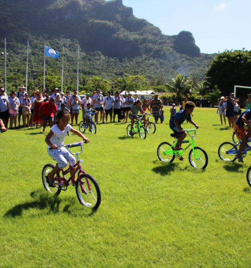 Photograph of a group of children riding bicycles